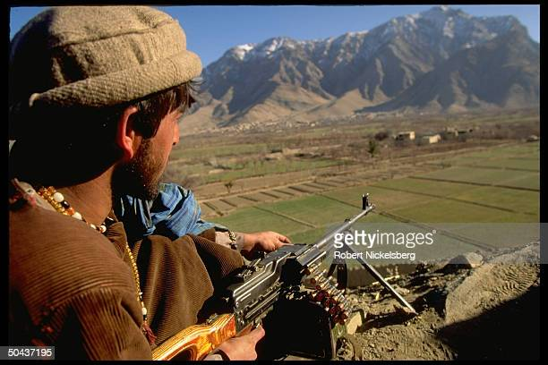 Prob Rabbani govt gunner on hilltop position overlooking fields in area of Taliban civil war factiontaken Charasiab HQ of Hekmatyar mujahedin outside...