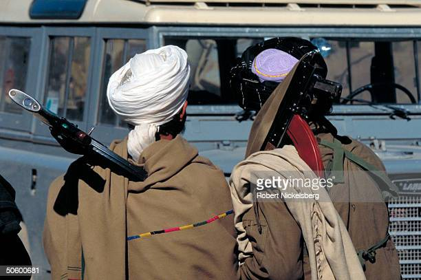 Prob Taliban fighters by jeep @ Islamic faction's HQ taken fr opposition Hekmatyar mujahedin by maj student army on top in factional civil war