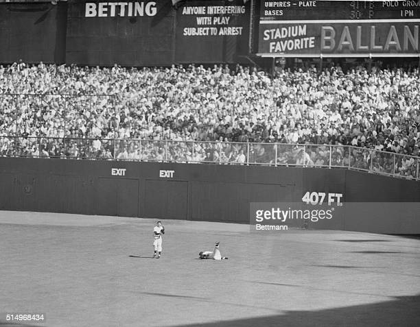 Probably the most dramatic moment of the second game of the World Series between the Yankees and the Giants at the Yankee Stadium is the one pictured...