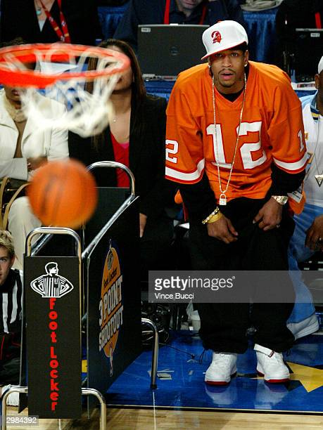 Probasketball player Allen Iverson watches the threepoint contest during the NBA AllStar Saturday Night festivities on February 14 2004 at the...