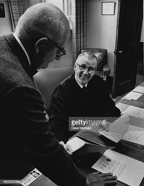 OCT 1962 OCT 31 1962 AUG 6 1985 Probation Fees Transferred District Judge Gerald E McAuliffe receives checks from Chief Probation Officer Frank C...