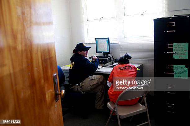 Probation officer helps a new arrival at Camp Kenyon Scudder fill out intake paperwork after arriving to serve her time at the girls detention...
