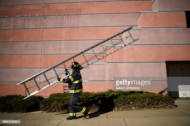Probationary firefighter Shannan Stensvad works on VEIS at an abandoned United Artists movie theater on December 19 2017 South Metro Fire and Rescue...