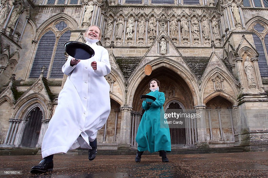 Probationers from Salisbury Cathedral Choir flip pancakes in front of the west door at Salisbury Cathedral on February 5, 2013 in Salisbury, England. The trainee choristers had to celebrate and learn about Shrove Tuesday a week early this year as they will be on half-term holiday for pancake day next week.