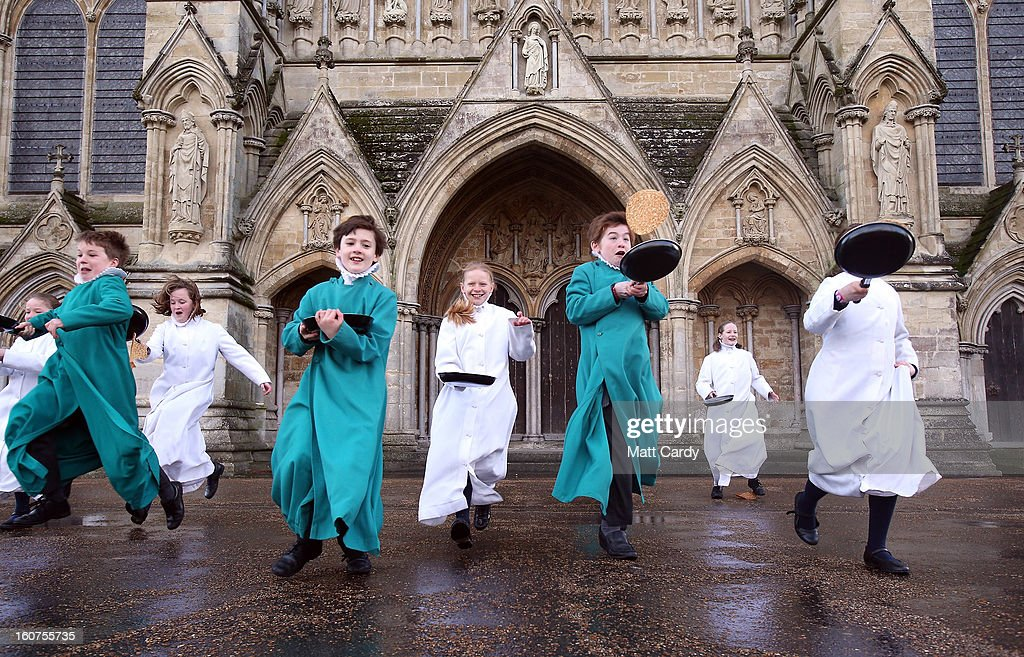 Probationers from Salisbury Cathedral Choir flip pancakes in front of Salisbury Cathedral on February 5, 2013 in Salisbury, England. The trainee choristers had to celebrate and learn about Shrove Tuesday a week early this year as they will be on half-term holiday for pancake day next week. Every year the choristers make pancakes to learn about the meaning of Shrove Tuesday, which is traditionally the day that all fats and flesh are eaten up to prepare for the forty days fast of Lent.