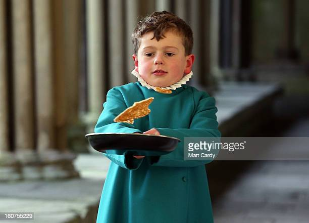 A probationers from Salisbury Cathedral Choir flips a pancake at Salisbury Cathedral on February 5 2013 in Salisbury England The trainee choristers...