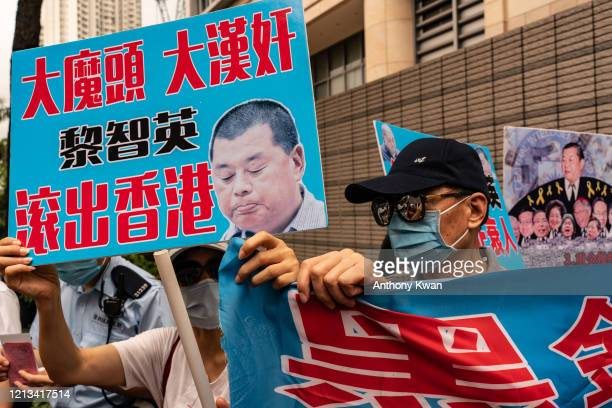 ProBeijing demonstrators hold placards and shout slogans outside of the West Kowloon Magistrates' Court on May 18 2020 in Hong Kong China 15...