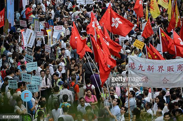 ProBeijing supporters gather outside the Legislative Council in Hong Kong on October 26 2016 Thousands of progovernment supporters protested against...