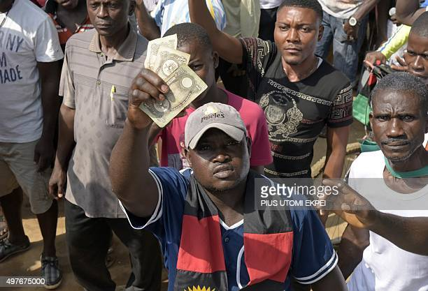 A proBiafra supporter holds outlawed Biafran banknotes during a protest in Aba southeastern Nigeria calling for the release of a key activist on...