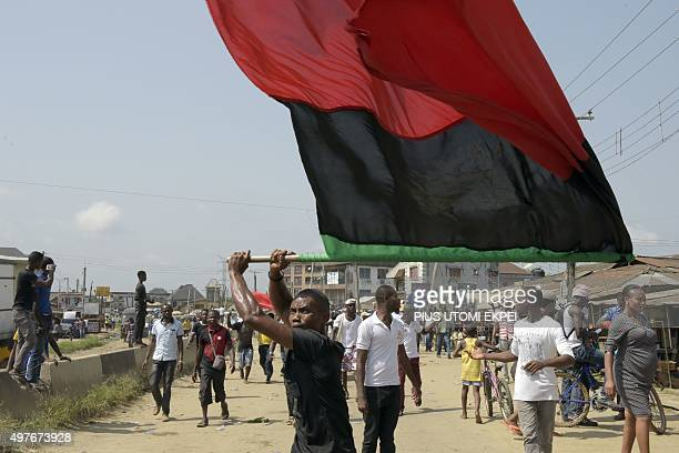 A proBiafra supporter waves a flag as people march in Aba southeastern Nigeria to call for the release of a key activist on November 18 2015 The...