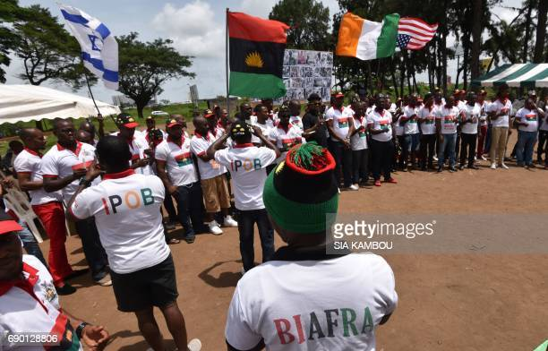 ProBiafra supports demonstrate with Biafra flag on May 30 2017 in Abidjan during commemorations of the 50th anniversary of the Nigerian civil war...