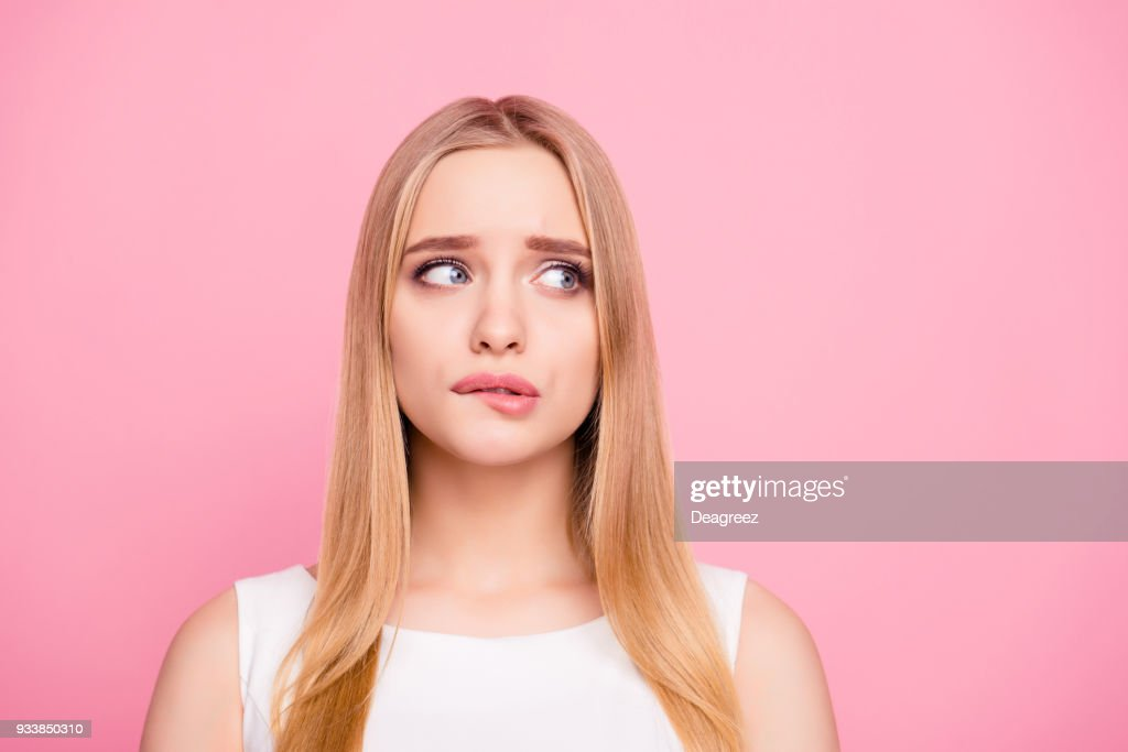 Problem trouble negative nervous sad unhappy upset people concept. Close up portrait of sweet charming tender gentle nervous beautiful attractive elegant stunning girl looking side isolated background : Stock Photo