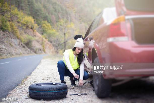 problem with a car. a broken car on the road. - flat tire stock pictures, royalty-free photos & images