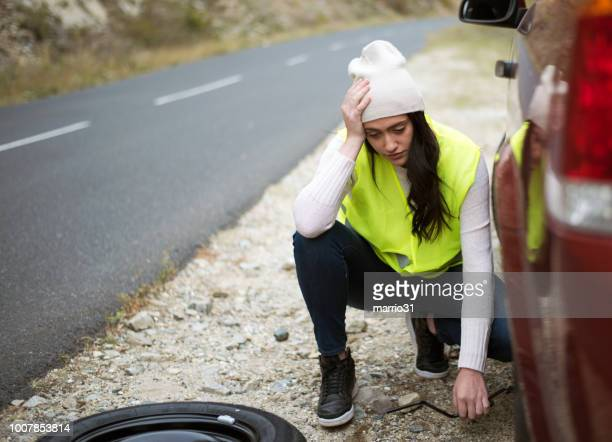 problem with a car - flat tire stock pictures, royalty-free photos & images