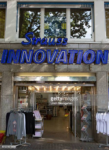 Problems Exterior view of Strauss Innovation branch in Bonn with the logo of the company
