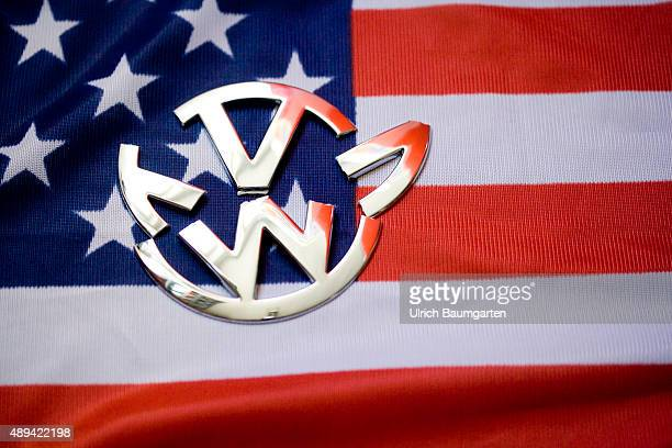 Problems Volkswagen and the manipulation allegations of US state institutions Our picture shows a broken Volkswagensymbol with American flag