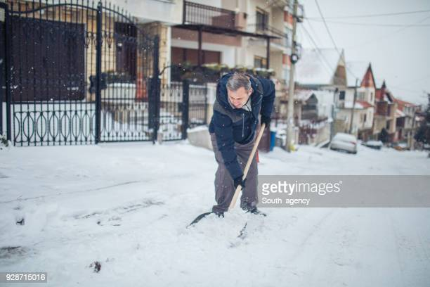 problems with snow - snow shovel stock photos and pictures