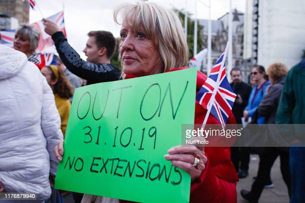 A proBrexit activist demonstrates in Parliament Square as it fills with proEU demonstrators from the mass 'Together for the Final Say' march...