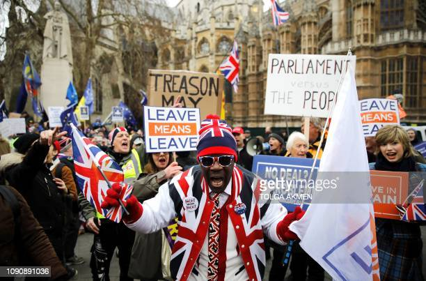 TOPSHOT A proBrexit activist dressed in Union flag themed clothes and sunglasses demonstrates opposite the Houses of Parliament in London on January...