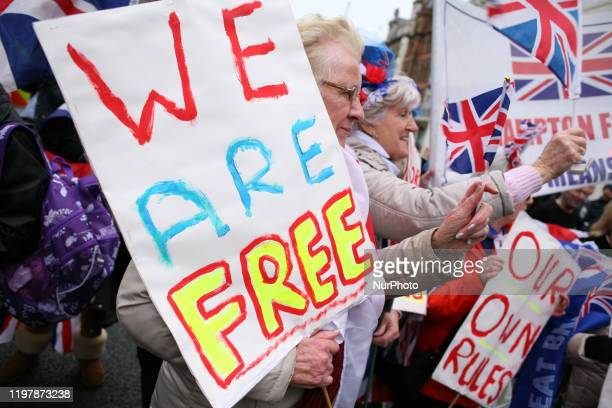 ProBrexit activists celebrate on Parliament Street in London England on January 31 2020 Britain's exit from the European Union today at 11pm UK time...