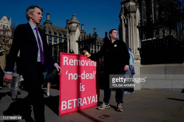 ProBrexit activists demonstrate outside the Houses of Parliament in central London on February 27 2019 Prime Minister Theresa May will today face a...