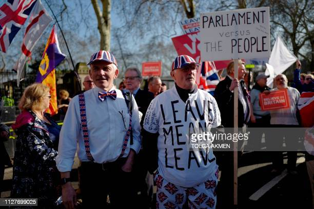ProBrexit activists march outside the Houses of Parliament in central London on February 27 2019 Prime Minister Theresa May will today face a vote by...