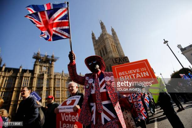 TOPSHOT ProBrexit activists march outside the Houses of Parliament in central London on February 27 2019 Prime Minister Theresa May will today face a...