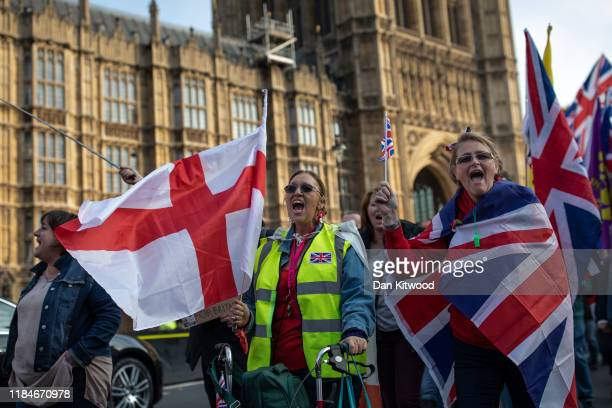 ProBrexit activists march outside the Houses of Parliament on what would have been the day that the United Kingdom left the European Union on October...