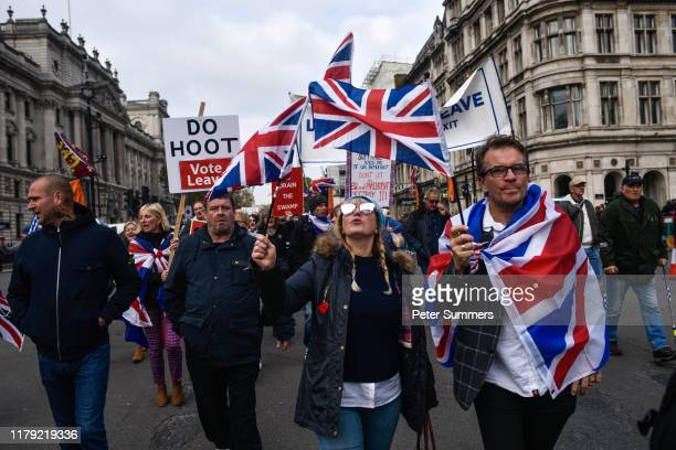 ProBrexit activists protest outside the Houses of Parliament on what would have been the day that the United Kingdom left the European Union on...