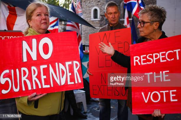 ProBrexit activists stand with placards on Abingdon Street outside the Houses of Parliament in London England on October 17 2019 Prime Minister Boris...