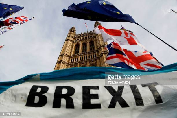 Pro-Brexit banner is seen outside the Houses of Parliament in London on October 30. 2019. - Britain's political leaders tested their election pitches...