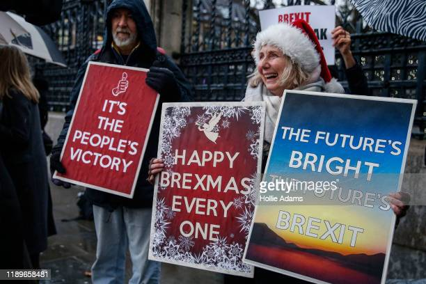 ProBrexit campaigners celebrate while holding placards near the Houses of Parliament on December 20 2019 in London England The EU Withdrawal...