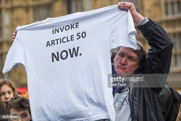 A proBrexit demonstrator holds up a tshirt during a protest outside the Houses of Parliament on November 23 2016 in London England British Prime...