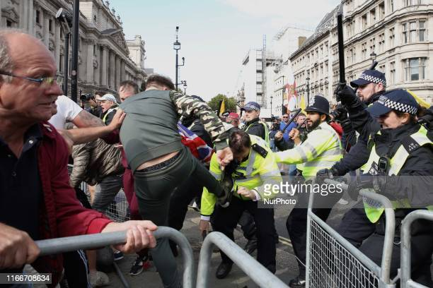 ProBrexit demonstrator kicks a policeman during clashed with polce forces at Parlament Square London England on Saturday September 7 2019 The...