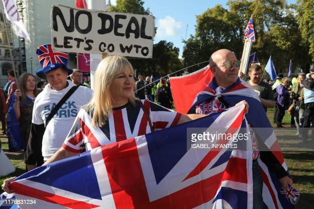 ProBrexit demonstrators are seen in Parliament Square in central London on October 19 ahead of a rally by activists from the People's Vote...