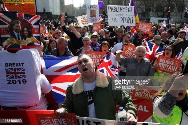 ProBrexit demonstrators carry placards and Union flags as they gather in Parliament Square in central London on March 29 2019 MPs are set for a...