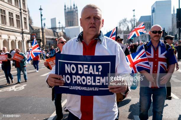 ProBrexit demonstrators hold placards as protesters gather in Parliament Square in central London on March 29 2019 British MPs on Friday rejected...