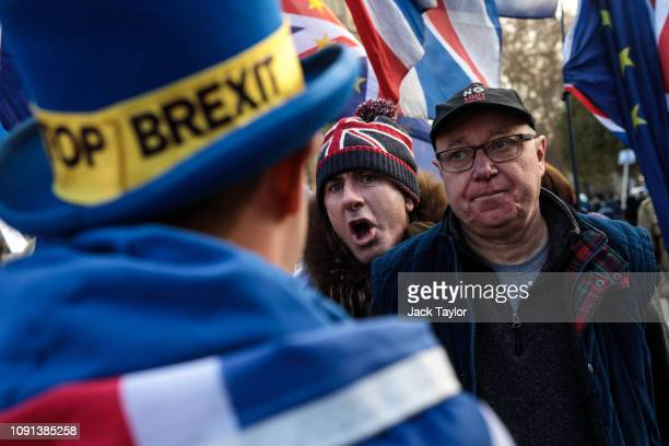 A proBrexit protester argues with antiBrexit protester Steve Bray during a demonstration outside the Houses of Parliament in Westminster on January...