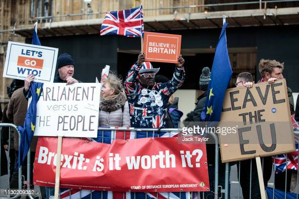 ProBrexit protesters demonstrate outside the Houses of Parliament on March 13 2019 in London England Last night MPs voted 242 to 391 against British...
