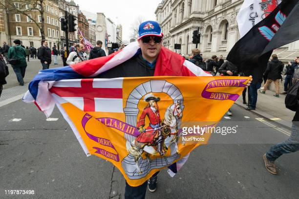ProBrexit supporter demonstrates outside Downing Street as thousands mark Brexit day on 31 January 2020 in London England Today Britain will formally...