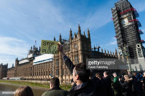 ProBrexit supporter holds antiEU placard on Westminster Bridge as Fishing for Leave campaigners stage a protest on the river Thames against the...