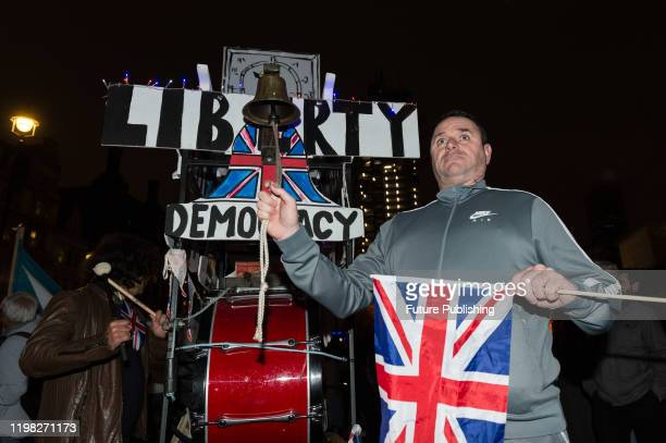Pro-Brexit supporter rings a bell as thousands take part in a rally celebrating Britain's departure from the EU in Parliament Square on 31 January,...