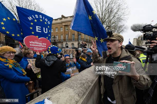Pro-Brexit supporter shouts at a group of pro-EU supporters demonstrating outside Downing Street on Brexit day on 31 January, 2020 in London,...