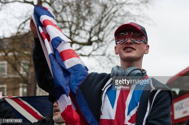 Pro-Brexit supporter wearing Union Jack glasses and t-shirt demonstrates outside Downing Street as thousands mark Brexit day on 31 January, 2020 in...