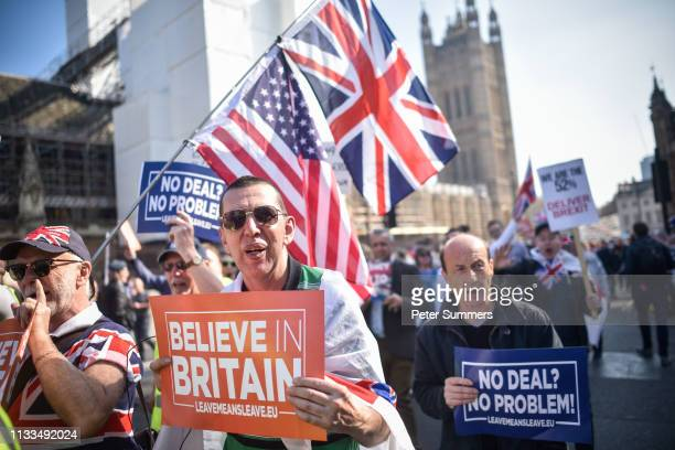 ProBrexit supporters march past the Houses of Parliament during a demo in Parliament Square on March 29 2019 in London England Today proBrexit...