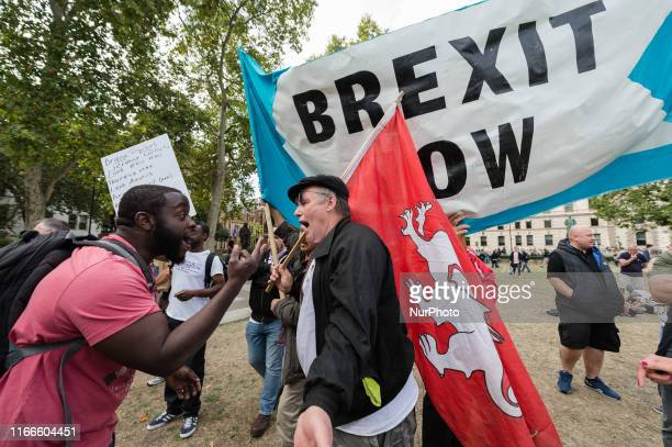 ProBrexit supporters of Tommy Robinson and Boris Johnson argue with a People's Vote demonstrator in Parliament Square on 07 September 2019 in London...