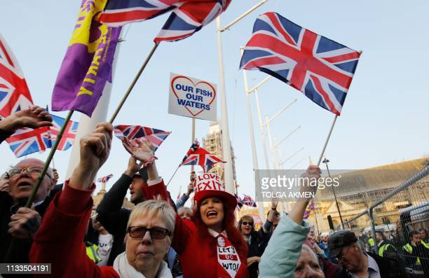 TOPSHOT ProBrexit supporters rally outside the Houses of Parliament in central London on March 29 2019 after MPs voted down the government's Brexit...