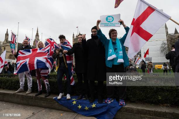 ProBrexit supporters trample over the EU flag in Parliament Square as they celebrate Brexit day on 31 January 2020 in London England Today Britain...