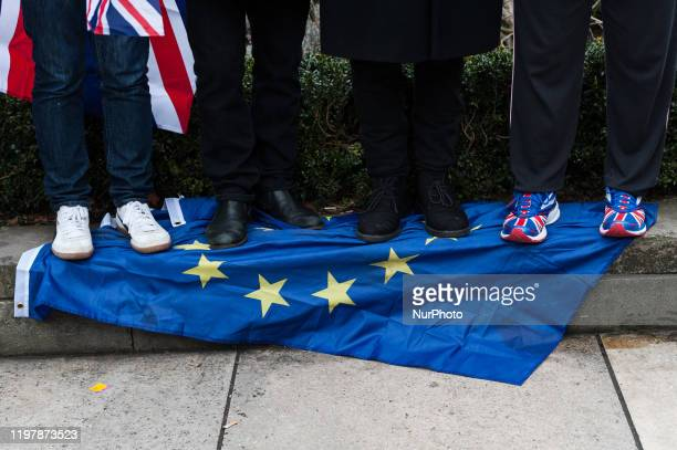 Pro-Brexit supporters trample over the EU flag in Parliament Square as they celebrate Brexit day on 31 January, 2020 in London, England. Today,...
