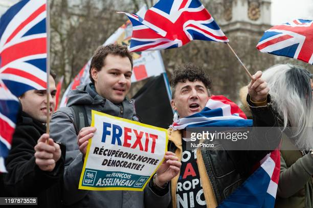 Pro-Brexit supporters wave British flags in Parliament Square as they celebrate Brexit day on 31 January, 2020 in London, England. Today, Britain...